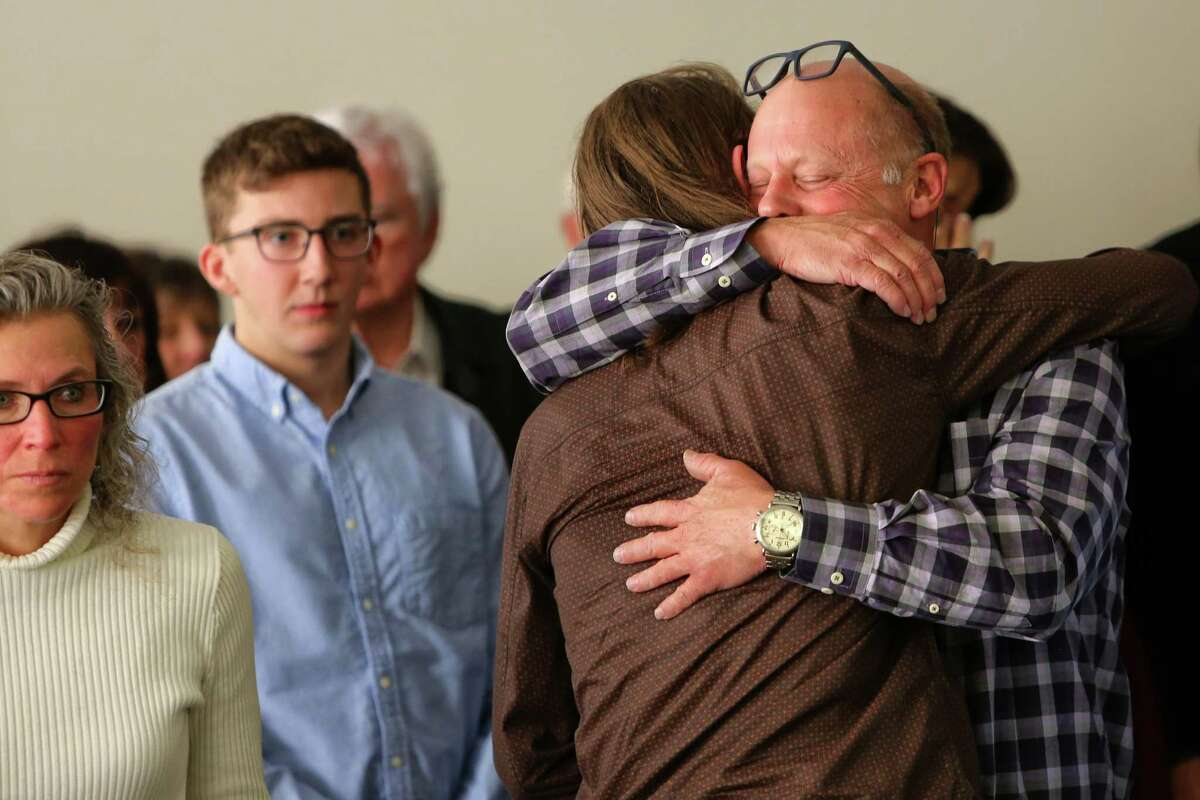 Surviving victim Will Kramer is hugged in the courtroom by friends during the sentencing hearing of Allen Ivanov, Thursday, Jan. 12, 2016. Ivanov pleaded guilty in December to shooting and killing three people at a Mukilteo house party in July. Ivanov fatally shot Bui, 19, and two other 19-year-olds, Jake Long and Jordan Ebner. A fourth person, Will Kramer, was also shot but survived.