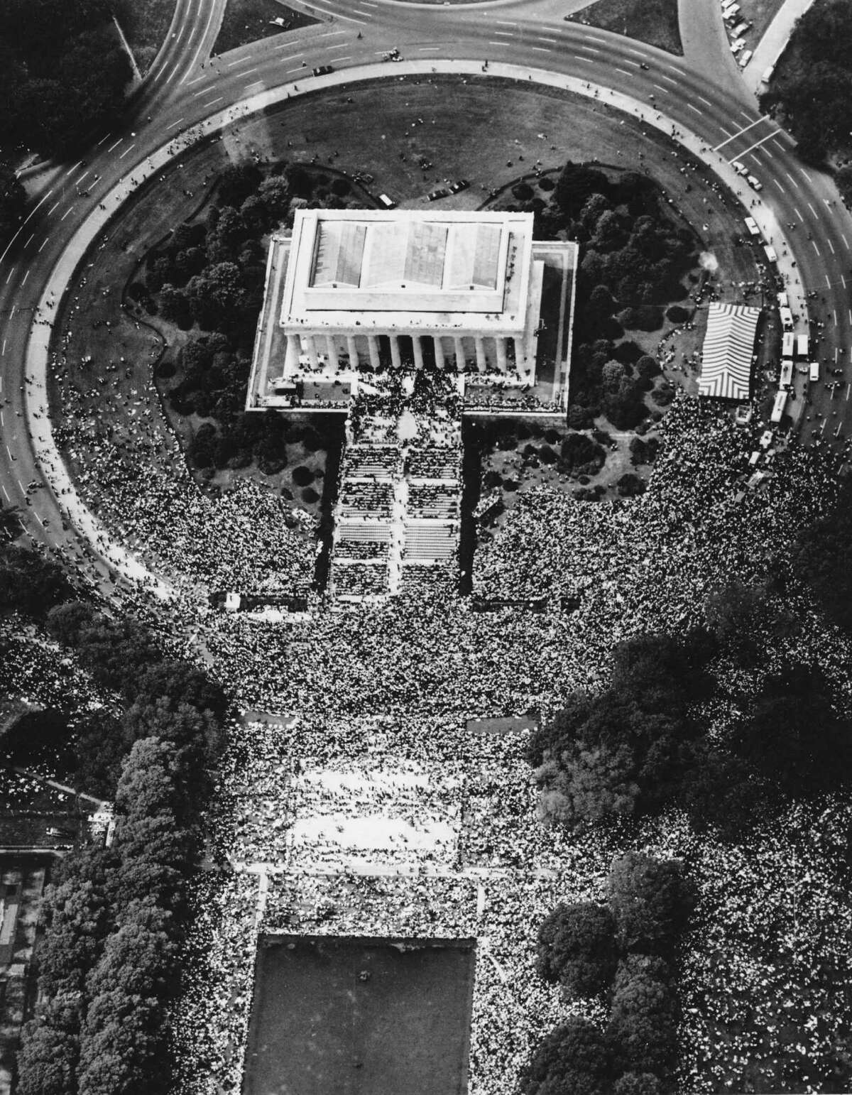 People crowd the Lincoln Memorial in Washington, D.C., ahead of Dr. Martin Luther King Jr.'s