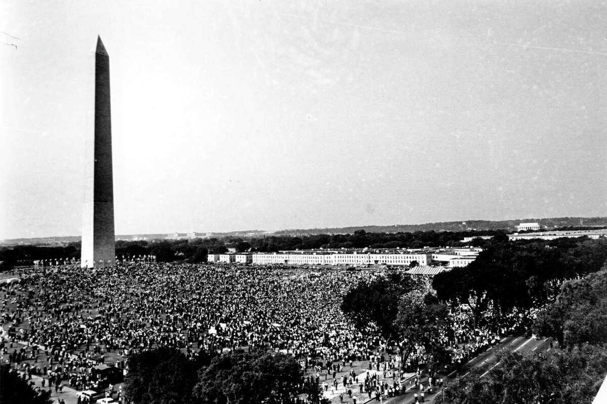 In this Aug. 28, 1963, file photo shows civil rights demonstrators gather at the Washington Monument grounds before noon, before marching to the Lincoln Memorial, seen in the far background at right, where the March on Washington for Jobs and Freedom will end with a speech by Rev. Martin Luther King Jr., now known as the