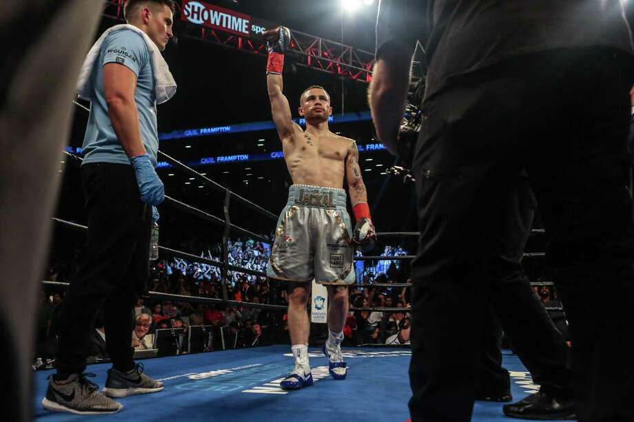 Carl Frampton of Northern Ireland celebrates his win after defeating Leo Santa Cruz of Mexico in the 12 round WBA super featherweight championship bout at Barclays Center on July 30, 2016 in New York City. Photo: Anthony Geathers /Getty Images / 2016 Getty Images