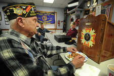 Trumbull VFW member Bob Sherwood, of Trumbull, has a slice of pizza following the bi-monthly meeting of members at VFW Post 10059 in Trumbull, Conn. on Thursday, January 12, 2016. Because of declining membership, members said they need the town to pick up more of their monthly costs or the post will be forced to return their building to the town.