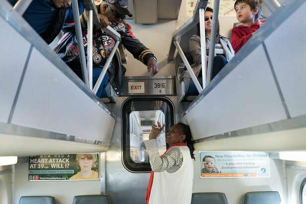 Seleste Graham, center, greets Eric Nichols as they ride The Celebration Train to San Francisco, Calif on Monday, Jan. 18, 2016. The Celebration Train, which goes from San Jose to San Francisco, was supposed to be canceled last year, but has been saved and is running again.