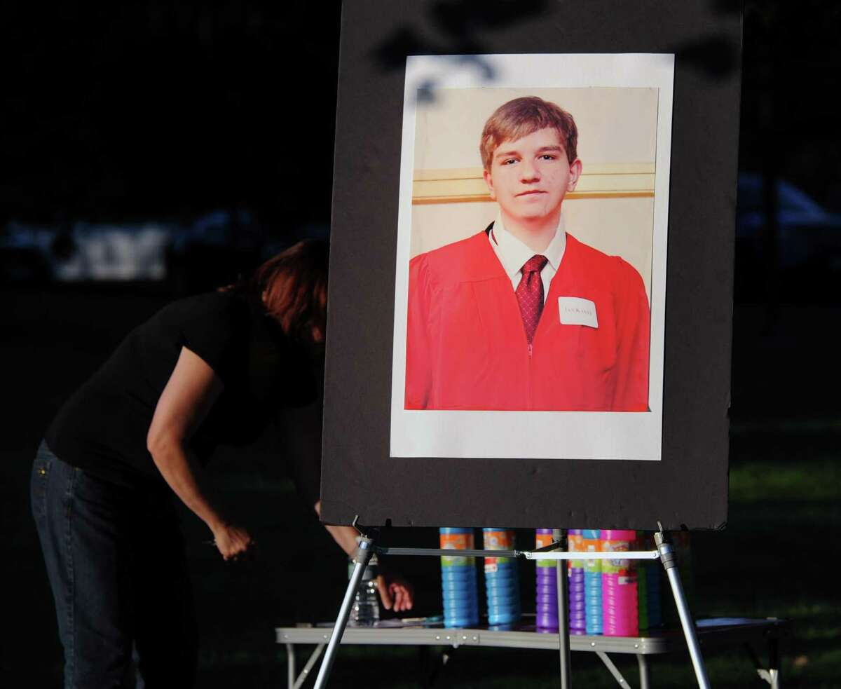 The memorial service in memory of Bart Palosz, pictured above in a poster photo, in Bruce Park in 2015. Palosz committed suicide on the first day of his sophomore year at Greenwich High School.