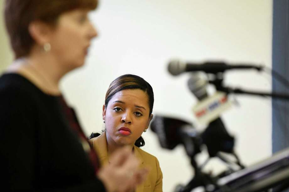 First Ward Council member Dorcey Applyrs listens as Mayor Kathy Sheehan, left, speaks during an event to commemorate the three year anniversary of first press conference held to bring to light the plight of the residents of Ezra Prentice Homes in the wake of an increase in oil train traffic on Thursday, Jan. 12, 2017, in Albany, N.Y. The housing complex sits adjacent to an oil tanker unloading site at the Port of Albany. (Will Waldron/Times Union) Photo: Will Waldron / 20039381A