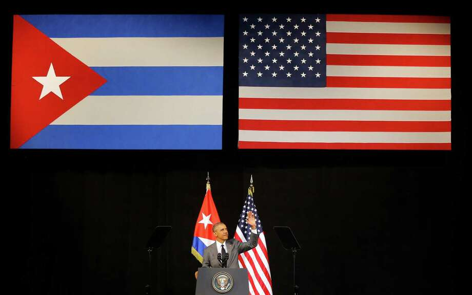 President Barack Obama speaks at the Grand Theater of Havana, Cuba on March 22, 2016. Obama is ending an immigration policy that allows any Cuban national who makes it to U.S. soil to stay. Photo: Desmond Boylan, STR / Copyright 2017 The Associated Press. All rights reserved.