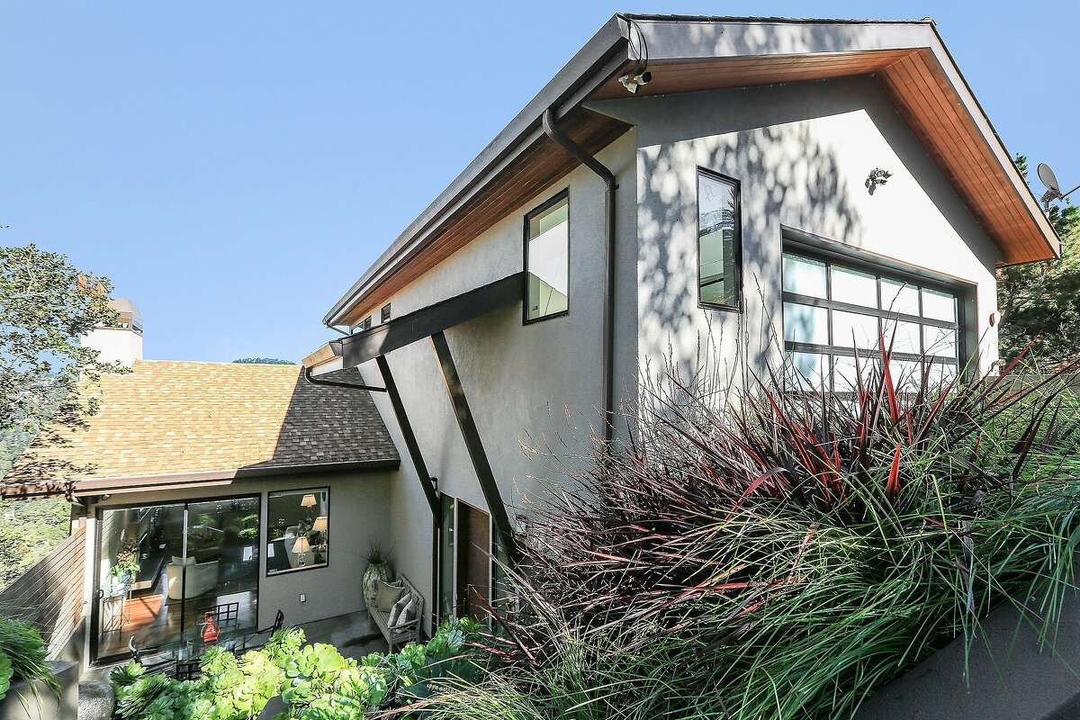 The hillside two-story contemporary in Piedmont Pines is available for $1.595 milion.