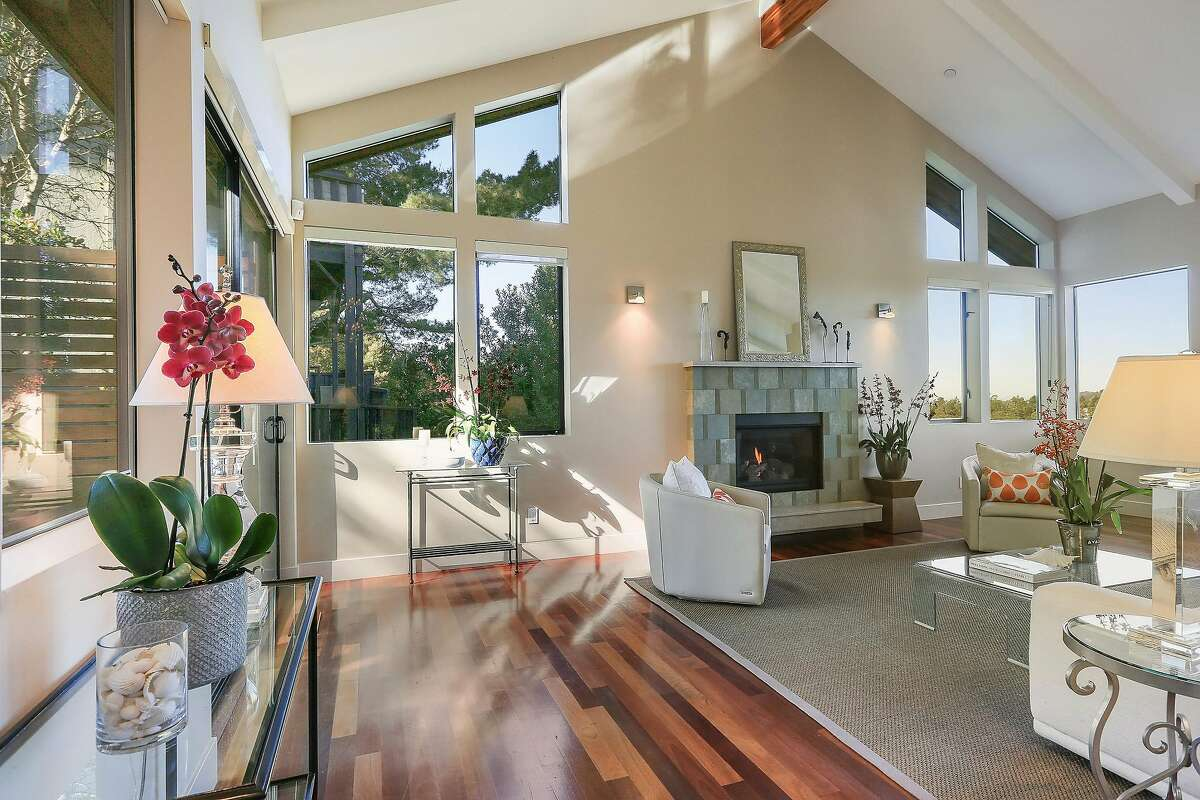 A voluminous great room enjoys views and natural light through large picture windows.