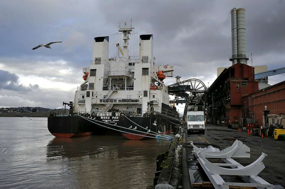 The cargo ship Moku Pahu is seen docked alongside the C&H Sugar refinery offloading its final load of raw sugar from Hawaii on Thursday Jan. 12, 2017, in Crockett, Ca. Photo: Michael Macor, The Chronicle