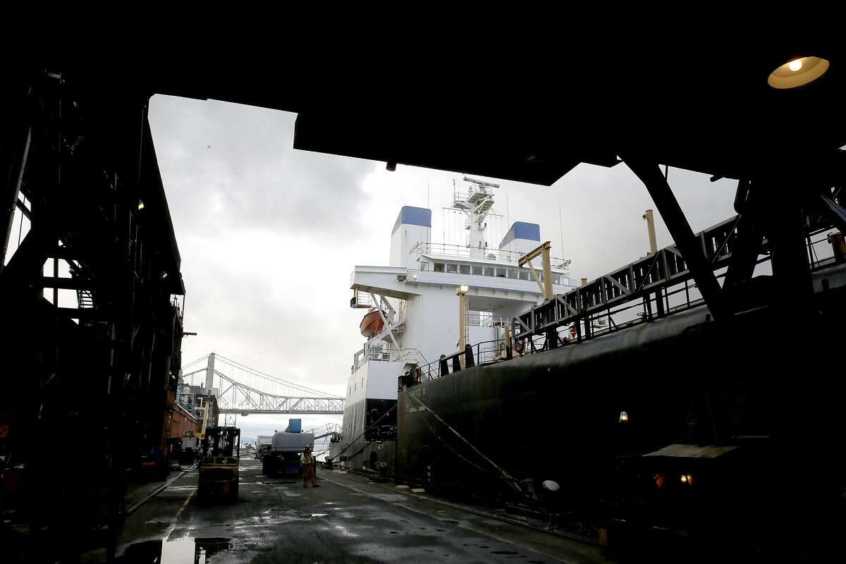 The cargo ship Moku Pahu is seen docked alongside the C&H Sugar refinery offloading its final load of raw sugar from Hawaii on Thursday Jan. 12, 2017, in Crockett, Ca.