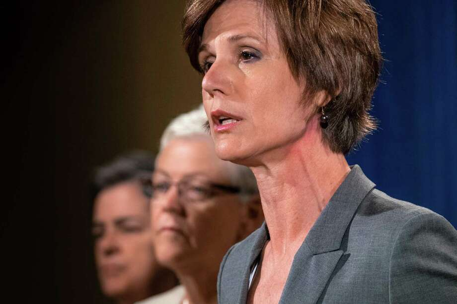 Deputy Attorney General Sally Yates (right) announces the settlement with Volkswagen during a Tuesday news conference at the Justice Department. She created the department's new guidelines for prosecuting corporate employees. Photo: J. David Ake /Associated Press / Copyright 2016 The Associated Press. All rights reserved. This material may not be published, broadcast, rewritten or redistribu