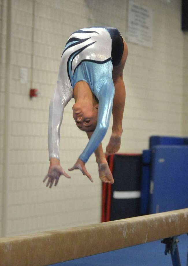 Wilton High School's Kate Ginsburg on the beam vs Greenwich on Thursday january 12, 2017 in Wilton Conn. Photo: Alex Von Kleydorff / Hearst Connecticut Media / Connecticut Post