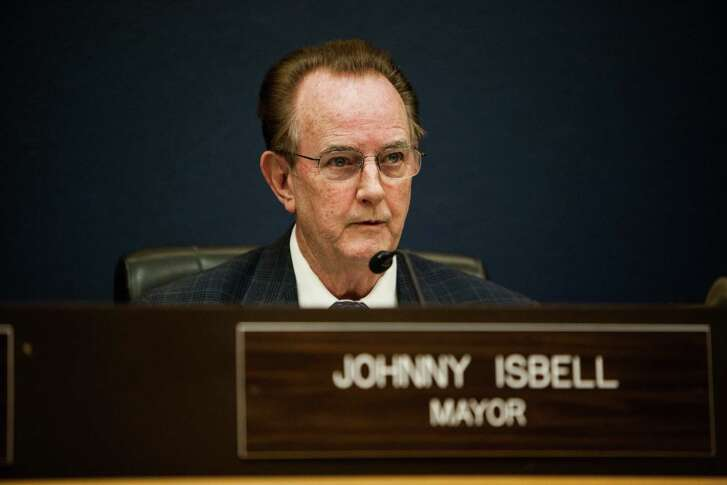 Pasadena Mayor Johnny Isbell address the crowd during a council meeting in Pasadena on April 15, 2014. During the meeting, the council voted on Ordinance 2014-073 to approve the districting of the city's six single-member council districts that established new districts. (Chronicle File Photo)
