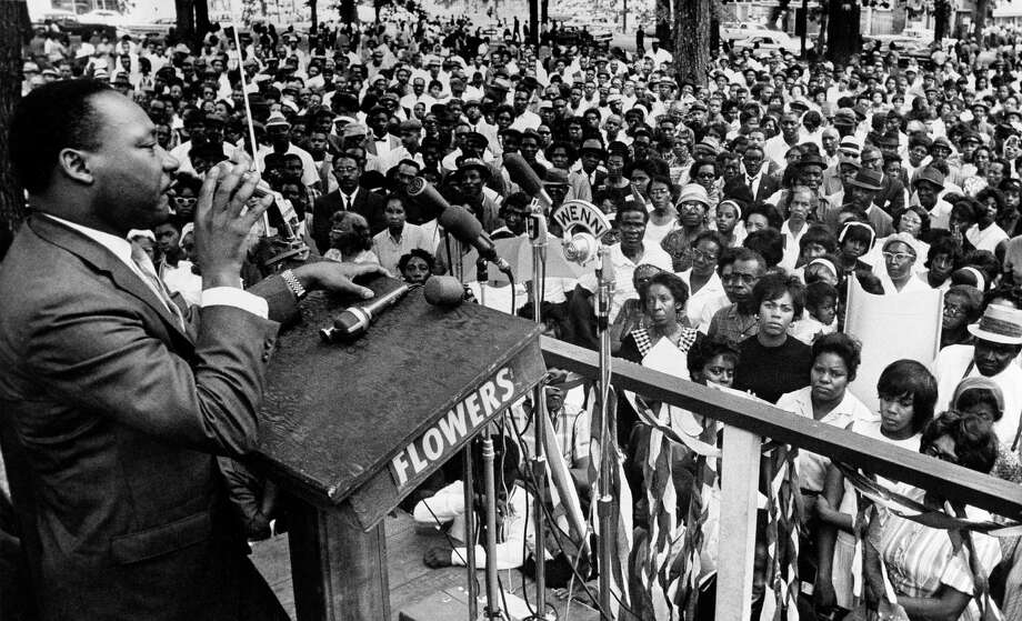 FILE - In this April 30, 1966 photo, The Rev. Martin Luther King Jr. addresses a crowd of some 3,000 persons in Birmingham, Ala., in Kelly Ingram Park on the last day of his three-day whistle-stop tour of Alabama, encouraging black voters to vote as a bloc in the primary election. President Barack Obama signed an order Thursday, Jan. 12, 2017, designating an historic civil rights district in Birmingham as a national monument, placing several blocks of a city once rocked by racial violence on par with landmarks including the Grand Canyon. (AP Photo/JT, File) Photo: JT, STR / Copyright 2017 The Associated Press. All rights reserved.