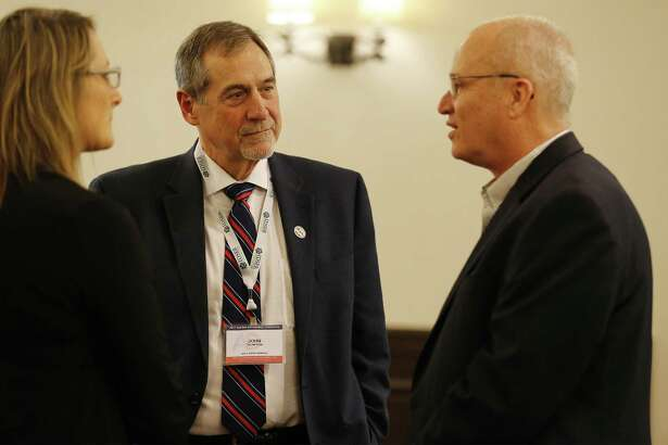 U.S. Census Bureau Director John Thompson (center) along with Lloyd Potter (right), UTSA professor and appointed state demographer, appear at the Applied Demography Conference, which happens every two years in San Antonio on Thursday, Jan. 12, 2017. Thompson, the keynote speaker at the event, talks about the changes happening with the 2020 Census, which will be the first that most Americans complete online instead of on paper. (Kin Man Hui/San Antonio Express-News)