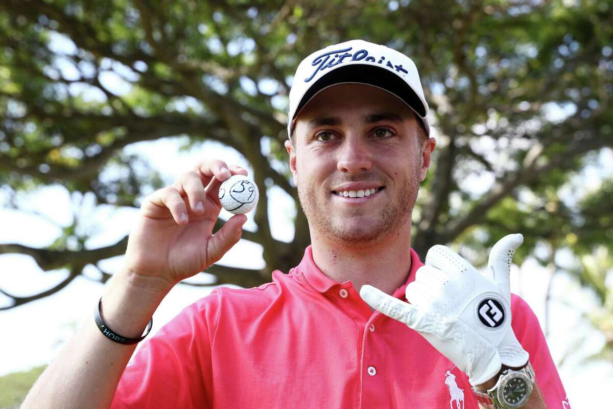HONOLULU, HI - JANUARY 12: Justin Thomas of the United States celebrates after scoring a 59 during the first round of the Sony Open In Hawaii at Waialae Country Club on January 12, 2017 in Honolulu, Hawaii. (Photo by Sam Greenwood/Getty Images)