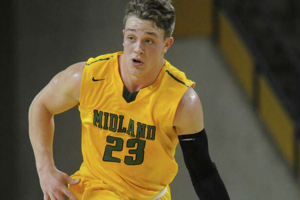 Midland College's Grant Weatherford (23) takes the ball down the court against Howard College on Thursday, Jan. 12, 2017, at Chaparral Center.  James Durbin/Reporter-Telegram