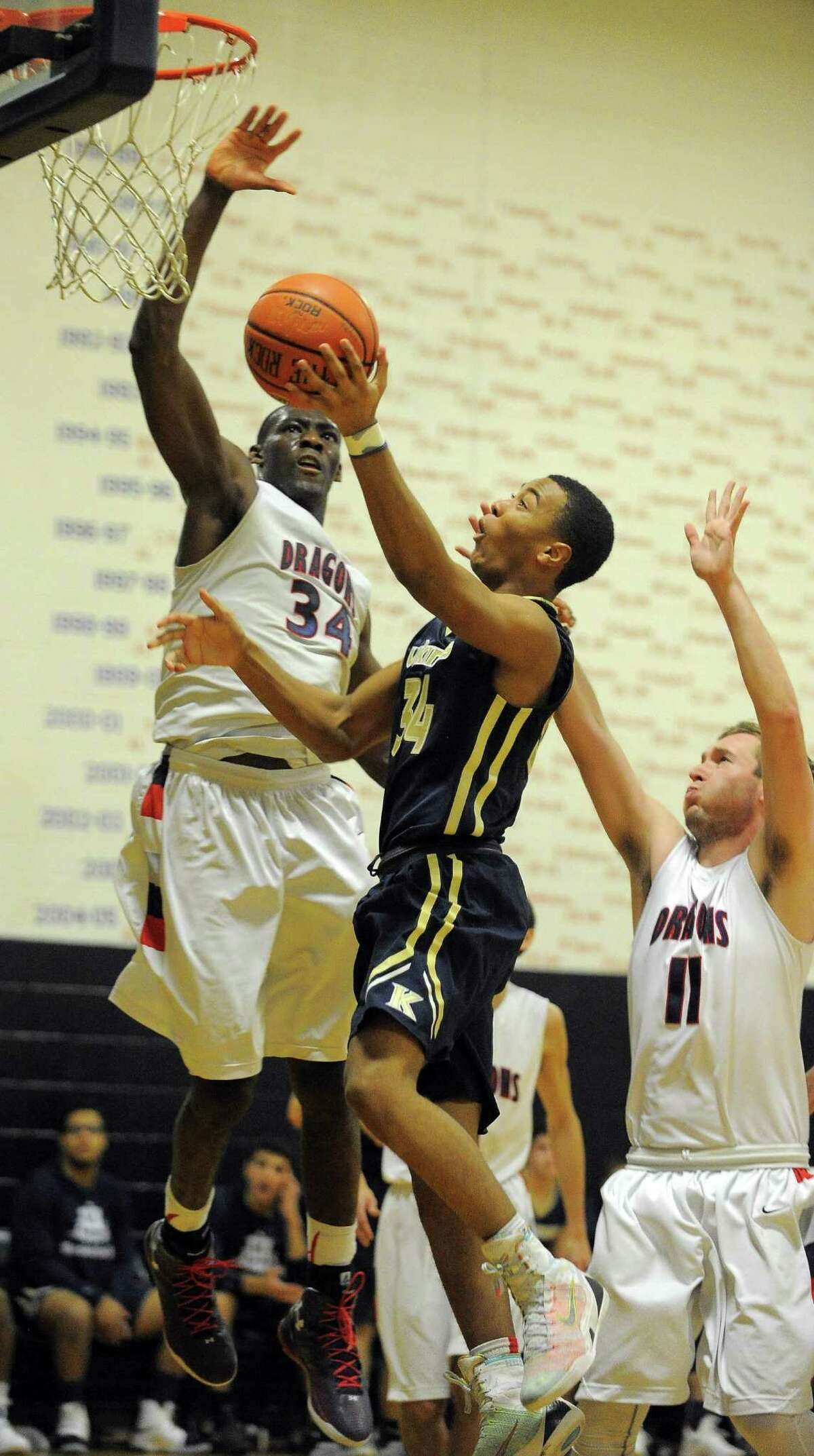 GFA's Sunday Okeke defends with Mack Mueller the shot of King A.J. Greene in a FAA varsity boys basketball game at King School in Stamford on Jan. 12, 2017. GFA defeated King 62-55 in overtime.