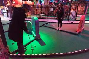 Dawn Vann, left, and Kylia Blackstock play mini-golf at Ghost Golf in Concord, Calif. on Thursday, Jan. 12, 2017. Daryn and his wife Janice Coleman combined their love for mini-golf with Disney animatronics by creating a haunted mansion meets Pirates of the Caribbean themed course.