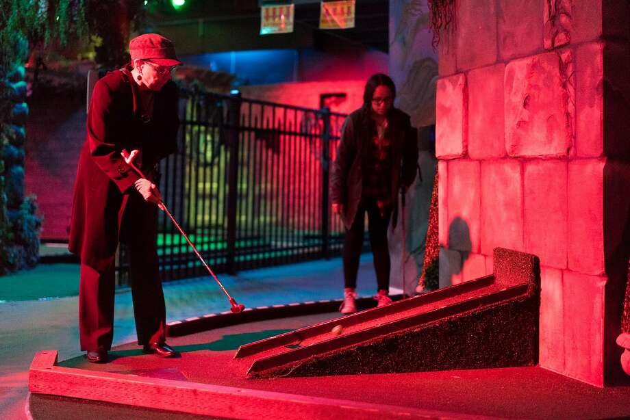 Dawna Vann, left, and Kylia Blackstock play mini-golf at Ghost Golf in Concord. Photo: James Tensuan, Special To The Chronicle