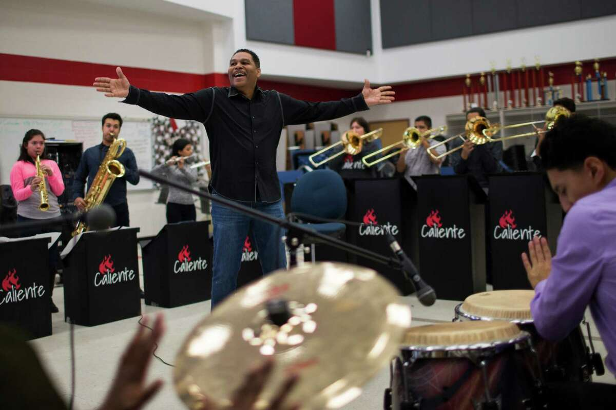Aldine ISD educator and composer Jose Antonio Diaz directs the music youth group Caliente.