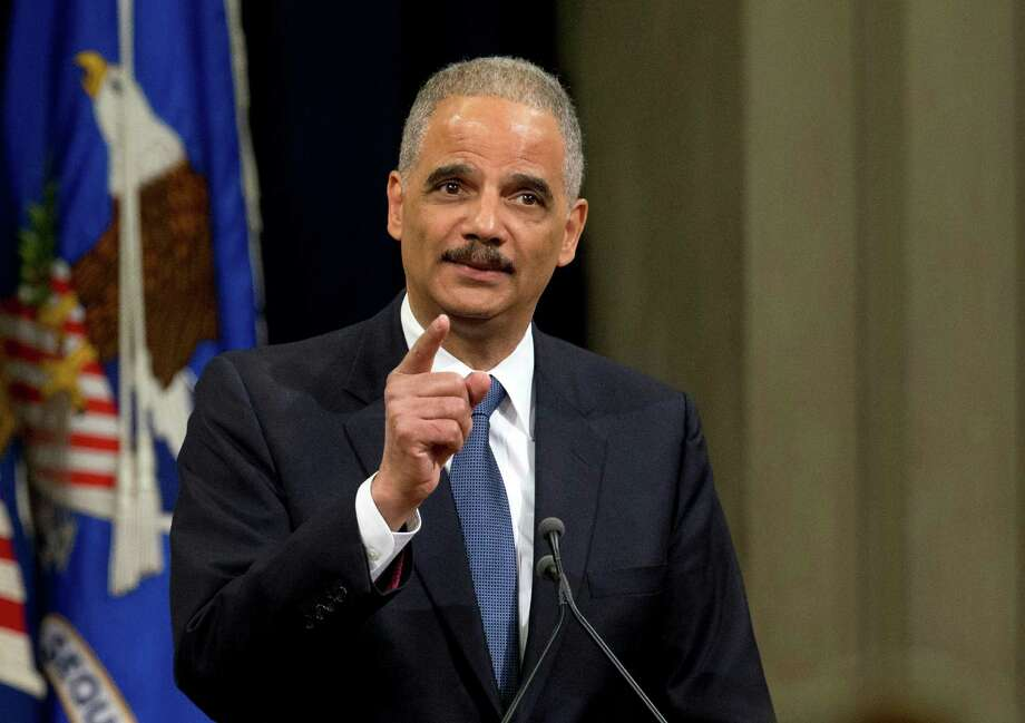 FILE - In this April 24, 2015 file photo, then-Attorney General Eric Holder speaks at the Justice Department in Washington. Holder on Thursday, Jan. 12, 2017, formally announced a new effort aimed at challenging the partisan gerrymandering that's left Democrats struggling to win local and state offices. (AP Photo/Manuel Balce Ceneta, File) ORG XMIT: WX102 Photo: Manuel Balce Ceneta / Copyright 2017 The Associated Press. All rights reserved.