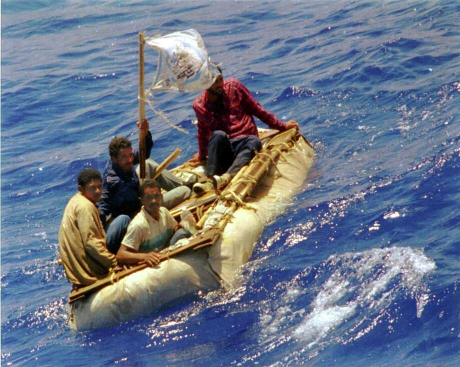 """FILE - Cuban refugees float in seas, 60 miles south of Key West, Fla. President Barack Obama announced Thursday, Jan. 12, 2017, he is ending a longstanding immigration policy that allows any Cuban who makes it to U.S. soil to stay and become a legal resident. Obama said in a statement. """"By taking this step, we are treating Cuban migrants the same way we treat migrants from other countries. (AP Photo/Dave Martin, File) Photo: Dave Martin, Associated Press / Copyright 2017 The Associated Press. All rights reserved."""