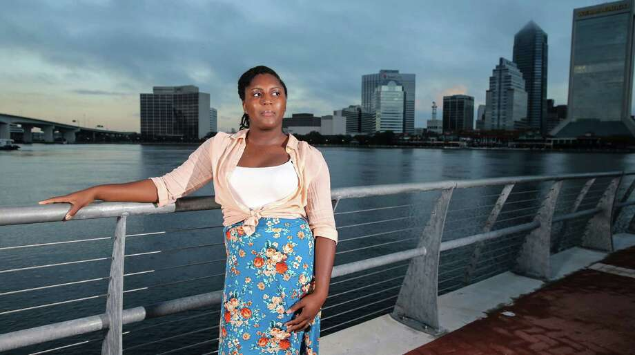 In this Thursday, Oct. 20, 2016, photo, Asia Howard poses for a photo at St. Johns River Park at sunrise, in Jacksonville, Fla. Howard was stuck in mostly retail and fast-food jobs after graduating high school, unable to get a job in banking, a profession she prized for its steady hours. After further developing her career and computer skills, she landed a job in mortgage lending that paid nearly double what she earned in previous jobs. Howard is now studying for an associate's degree in business administration at Florida State College at Jacksonville. (AP Photo/Gary McCullough) ORG XMIT: FLGM461 Photo: Gary McCullough / FR171182 AP