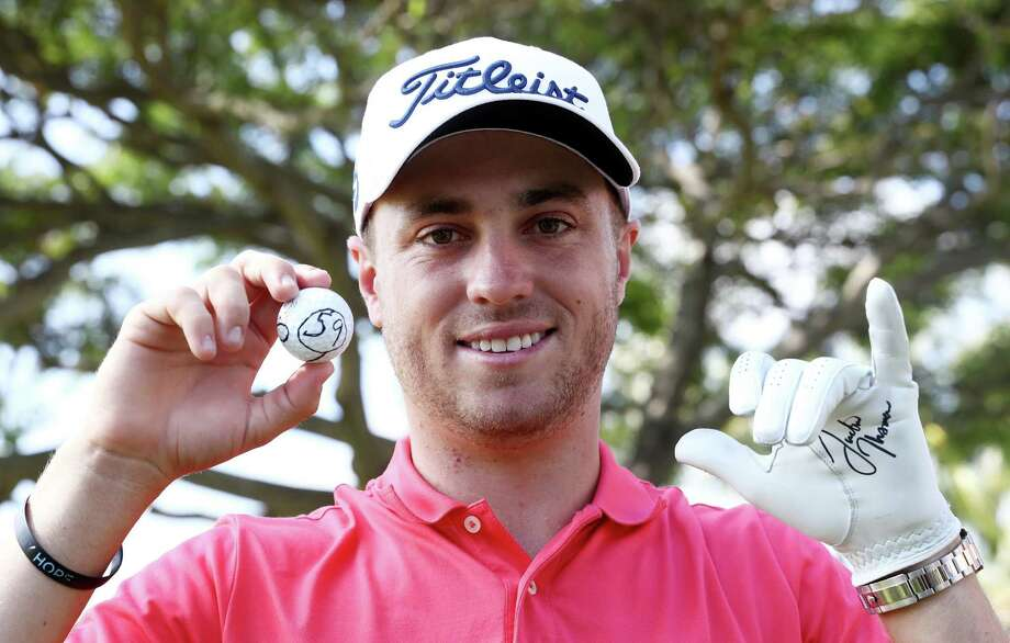 HONOLULU, HI - JANUARY 12:  Justin Thomas of the United States celebrates after scoring a 59 during the first round of the Sony Open In Hawaii at Waialae Country Club on January 12, 2017 in Honolulu, Hawaii.  (Photo by Sam Greenwood/Getty Images) ORG XMIT: 686510539 Photo: Sam Greenwood / 2017 Getty Images