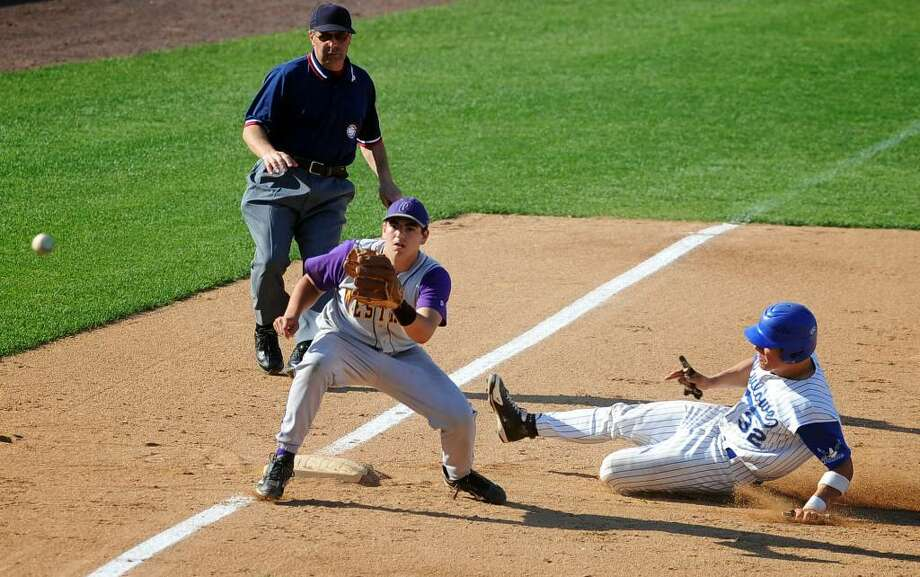 Fairfield Ludlowe's Tom Nagy steals third base as Westhill's Sam Kosterich waits for the ball during the FCIAC Baseball semi-final game Tuesday May 25, 2010 at the Ballpark at Harbor Yard in Bridgeport. Photo: Autumn Driscoll / Connecticut Post
