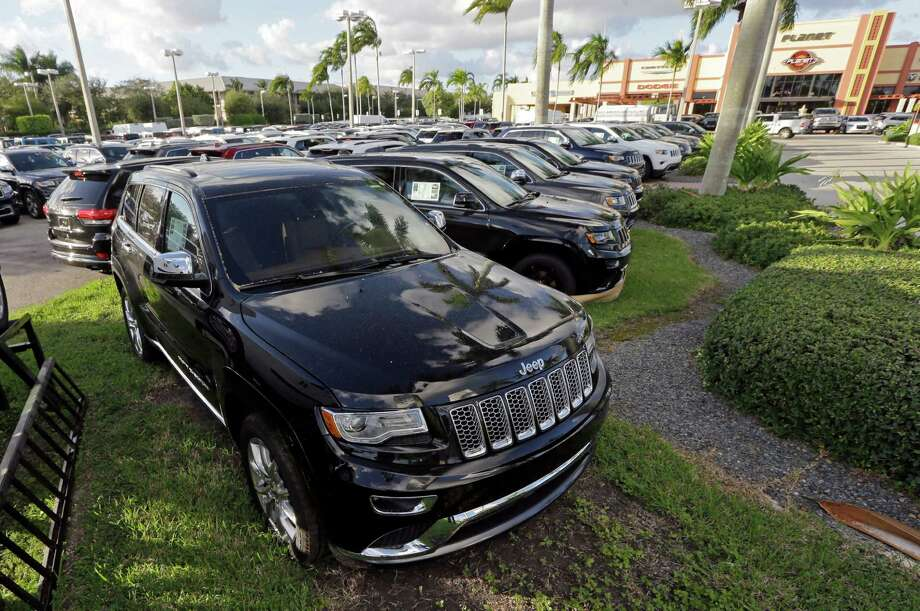 Jeep Grand Cherokees are on display in Doral, Fla., in 2015. The EPA accused Fiat Chrysler of installing secret software that allowed 104,000 of its diesel vehicles to emit pollutants above legal levels. Photo: Alan Diaz, STF / Copyright 2016 The Associated Press. All rights reserved. This material may not be published, broadcast, rewritten or redistribu