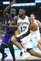 Jonathon Simmons streaks to the hoop in the first half against Luol Deng as the Spurs host the Lakers at the AT&T Center on January, 12, 2017.