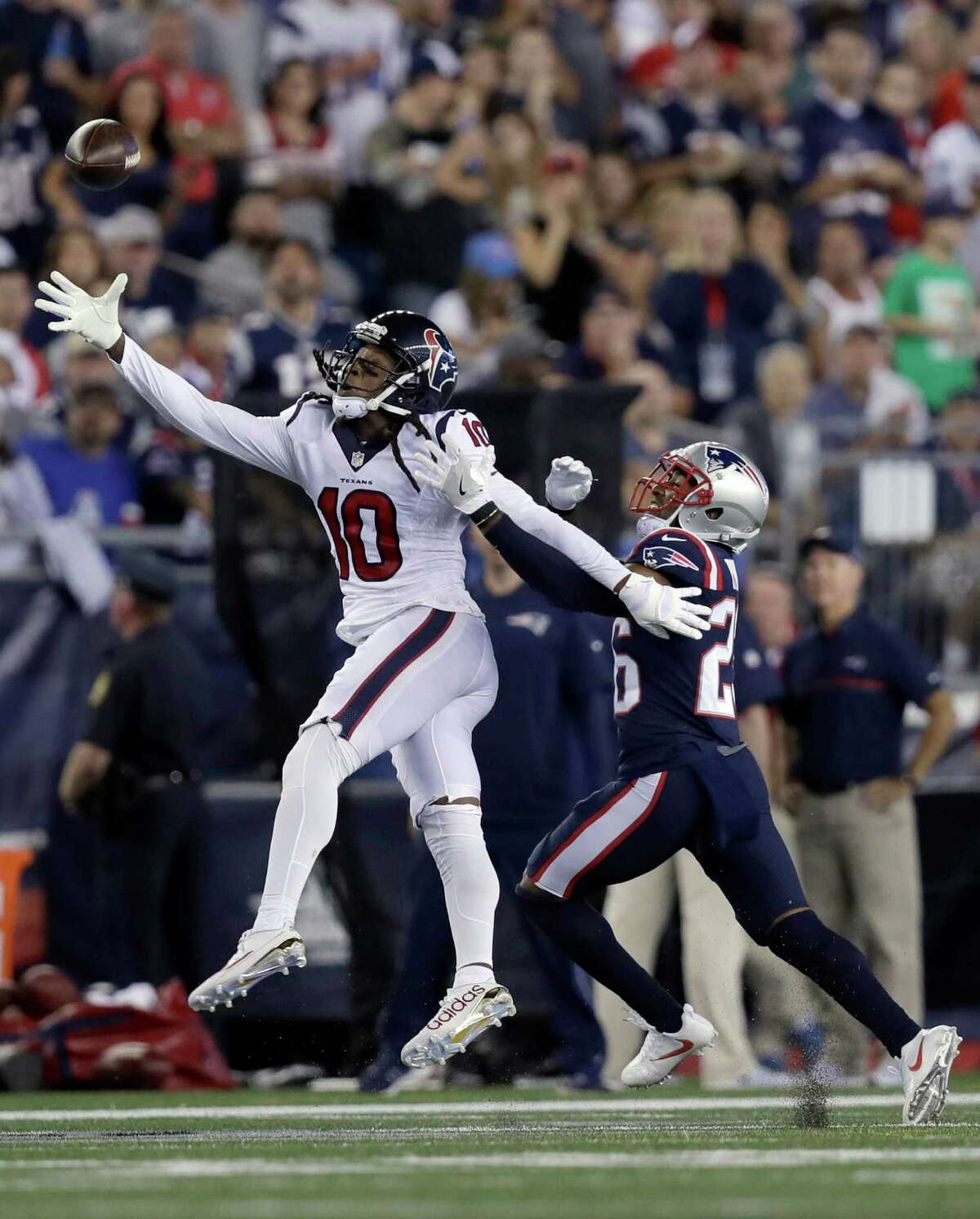 Houston Texans wide receiver DeAndre Hopkins (10) can't catch a pass as New England Patriots cornerback Logan Ryan (26) defends during the first half of an NFL football game Thursday, Sept. 22, 2016, in Foxborough, Mass. (AP Photo/Charles Krupa)