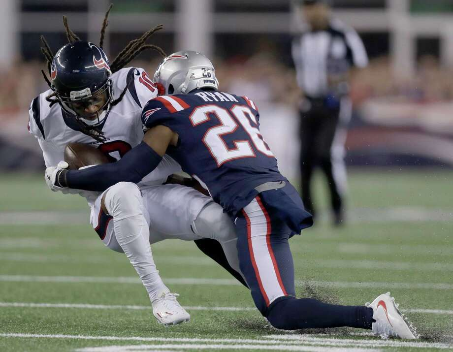 New England Patriots cornerback Logan Ryan (26) tackles Houston Texans wide receiver DeAndre Hopkins during the first half of an NFL football game Thursday, Sept. 22, 2016, in Foxborough, Mass. (AP Photo/Charles Krupa) Photo: Charles Krupa, STF / Copyright 2016 The Associated Press. All rights reserved.