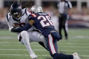 New England Patriots cornerback Logan Ryan (26) tackles Houston Texans wide receiver DeAndre Hopkins during the first half of an NFL football game Thursday, Sept. 22, 2016, in Foxborough, Mass. (AP Photo/Charles Krupa)