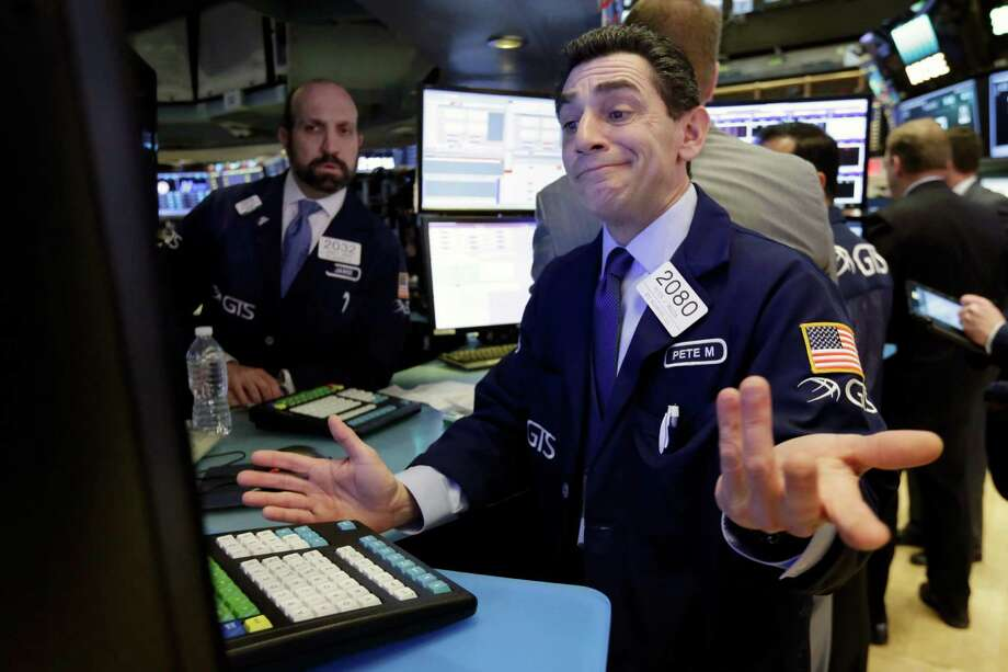Specialist Peter Mazza works at his post on the floor of the New York Stock Exchange, Thursday, Jan. 12, 2017. U.S. stocks moved broadly lower in early trading Thursday, giving back the market's gains from the day before. (AP Photo/Richard Drew) Photo: Richard Drew, STF / AP