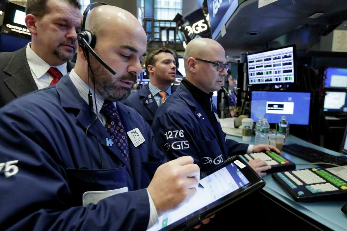 Fred DeMarco, left, and Mario Picone, right, work on the floor of the New York Stock Exchange, Thursday, Jan. 12, 2017. U.S. stocks moved broadly lower in early trading Thursday, giving back the marketÂ?'s gains from the day before. (AP Photo/Richard Drew)