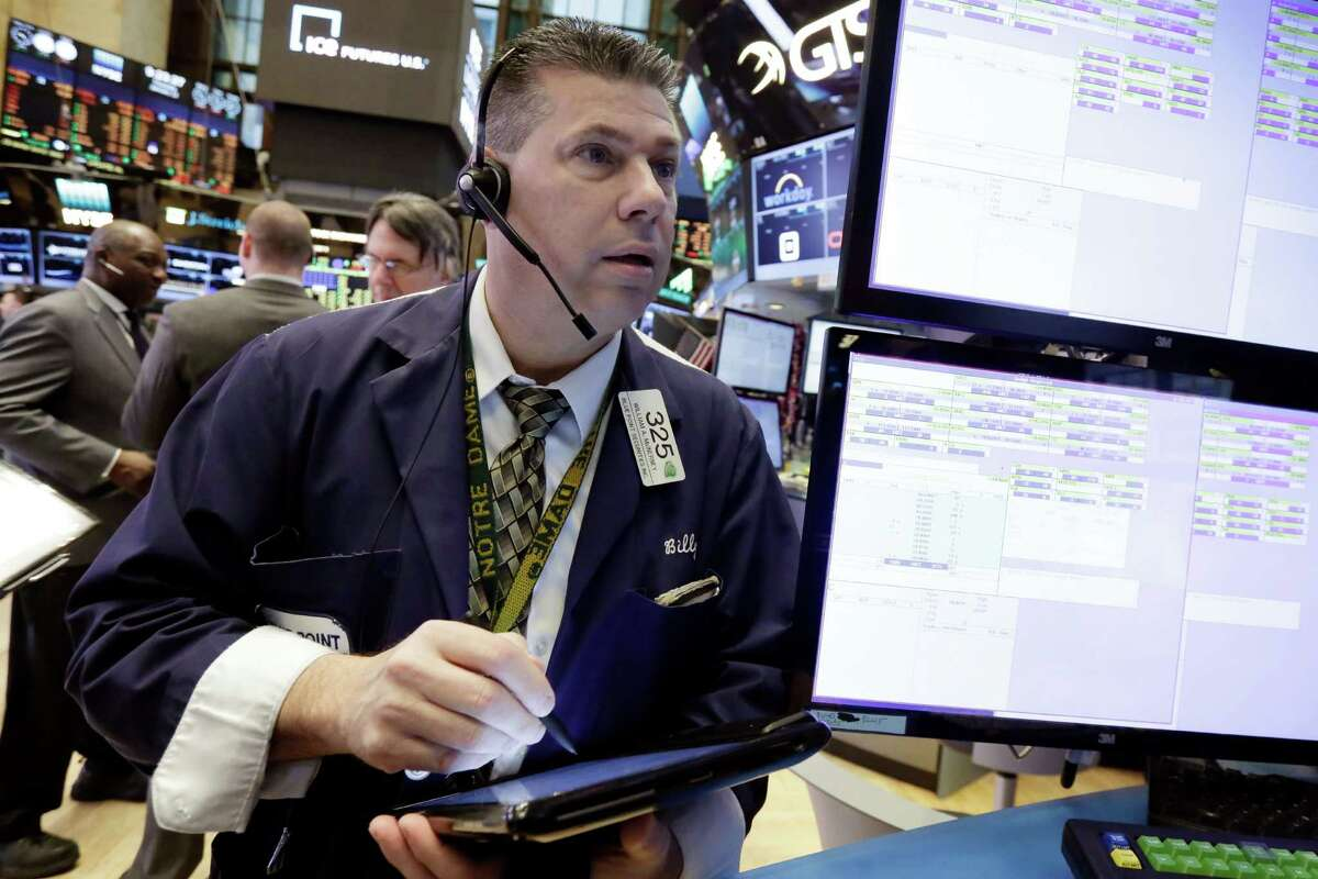 Trader William McInerney works on the floor of the New York Stock Exchange, Thursday, Jan. 12, 2017. U.S. stocks moved broadly lower in early trading Thursday, giving back the marketÂ?'s gains from the day before. (AP Photo/Richard Drew)