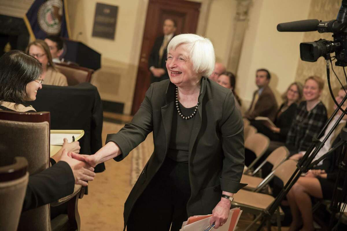 Janet Yellen greets educators Thursday at the Federal Reserve Board Building. She says the study of economics can help students with critical thinking.