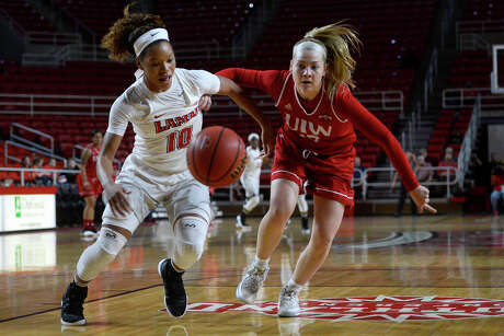Lamar guard Chastadie Barrs and Incarnate Word's Melina Merritt battle for a loose ball in a women's basketball game at the Montagne Center on Thursday evening.  Photo taken Thursday 1/12/17 Ryan Pelham/The Enterprise Photo: Ryan Pelham / ©2017 The Beaumont Enterprise/Ryan Pelham