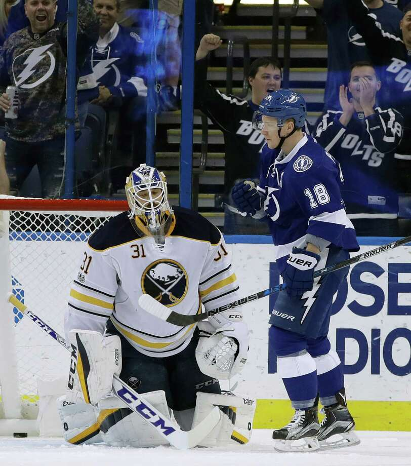 Tampa Bay Lightning left wing Ondrej Palat (18) pumps his fist after scoring a power play goal past Buffalo Sabres goalie Anders Nilsson (31) during the first period of an NHL hockey game Thursday, Jan. 12, 2017, in Tampa, Fla.(AP Photo/Chris O'Meara) ORG XMIT: TPA101 Photo: Chris O'Meara / Copyright 2017 The Associated Press. All rights reserved.