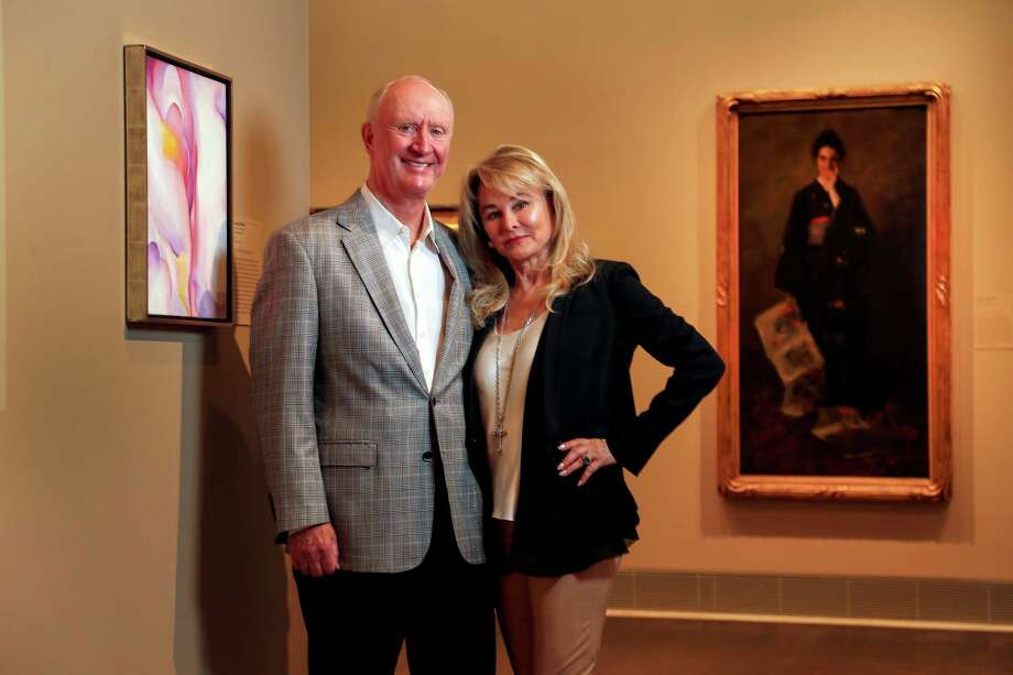 "Frank and Michelle Hevrdejs photographed with their collection of still life paintings in their exhibition ""Two Centuries of American Still-Life Painting: The Frank and Michelle Hevrdejs Collection"" at the Museum of Fine Arts, Houston, Thursday, January 12, 2017. Photo: Karen Warren, Houston Chronicle / 2016 Houston Chronicle"