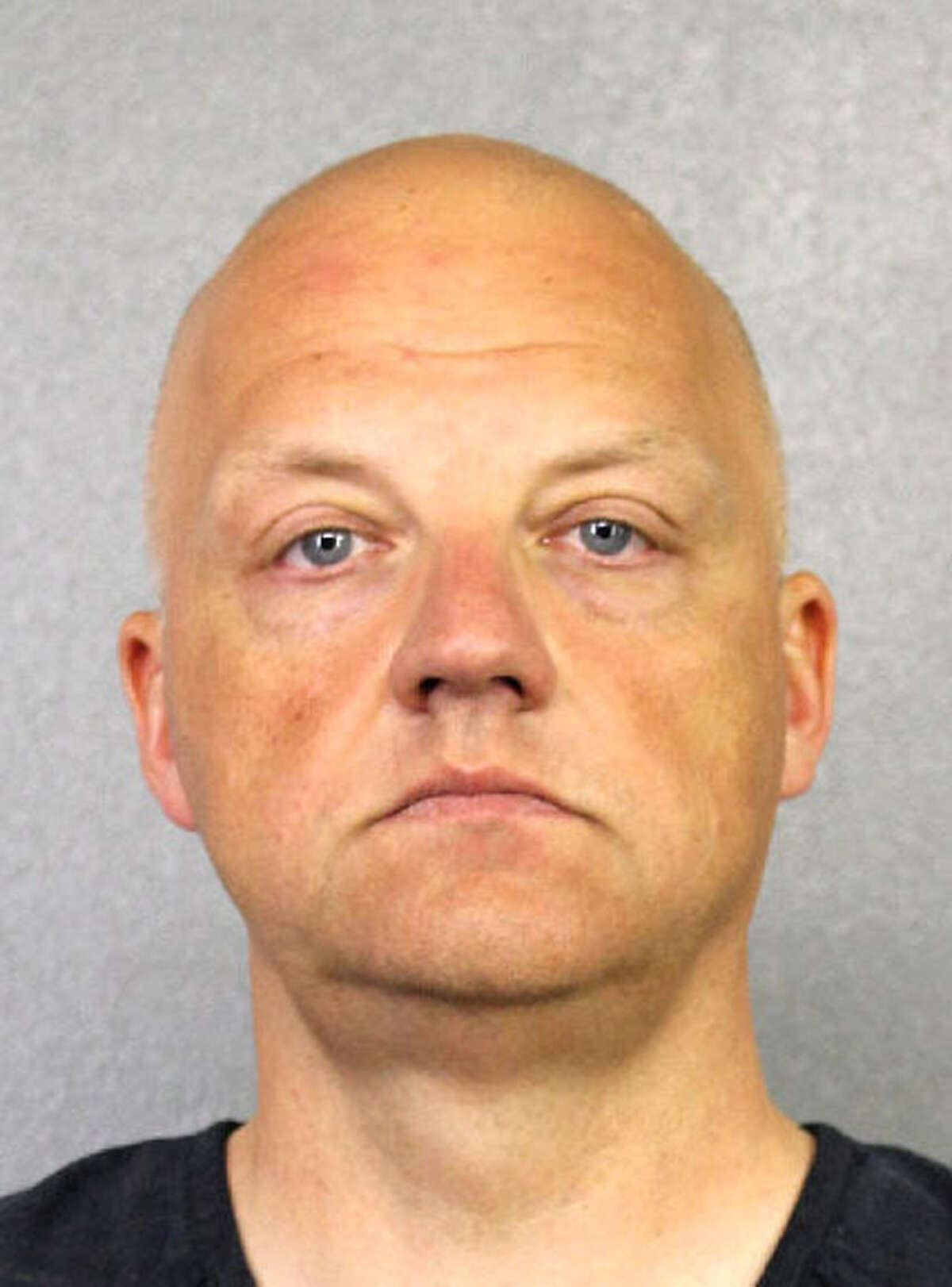 FILE- This file photo provided by the Broward County Sheriff's Office shows Oliver Schmidt under arrest on Jan. 7, 2017. Schmidt, the general manager of the engineering and environmental office for Volkswagen America, was arrested in connection with the company's emissions-cheating scandal. Schmidt goes before a federal judge Thursday, Jan. 12, 2017, seeking release on bail. (Broward County Sheriff's Office via AP, File)