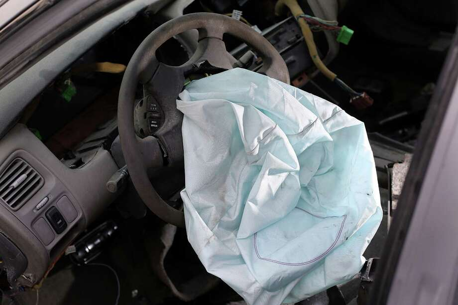 A deployed airbag is seen in a 2001 Honda Accord. Takata's auto safety recall is the largest ever. Photo: Joe Raedle, Staff / 2015 Getty Images
