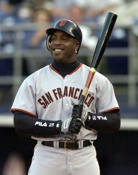 San Francisco Giants' Barry Bonds sports a big grin as he is intentionally walked in the first inning of the Giants game against the San Diego Padres in San Diego, in this June 3, 2002 photo. Photo: DENIS POROY, AP