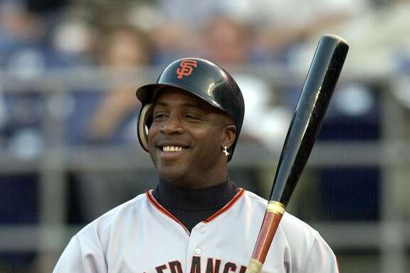 ** ADVANCE FOR WEEKEND EDITIONS, JUNE 15-16 -- FILE -- ** San Francisco Giants' Barry Bonds sports a big grin as he is intentionally walked in the first inning of the Giants game against the San Diego Padres in San Diego, in this June 3, 2002 photo. In 1998, Arizona manager Buck Showalter considered Bonds such a threat that he had him intentionally walked with the bases loaded. And that was years before Barry Bonds broke the single-season home run record.(AP Photo/Denis Poroy)