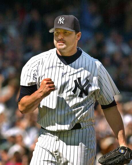 New York Yankees' Roger Clemens pumps his fist in the eighth inning against the Minnesota Twins, Sunday, May 19, 2002 at Yankee Stadium in New York. Photo: KATHY WILLENS, AP