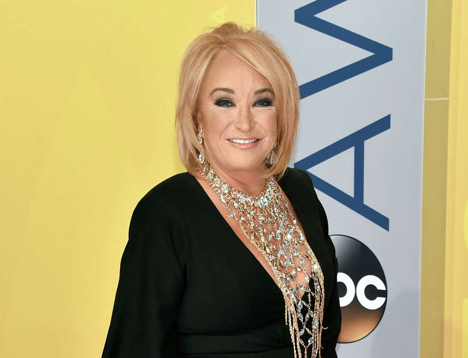 FILE - This Nov. 2, 2016 file photo shows Tanya Tucker at the 50th annual CMA Awards in Nashville, Tenn. Tucker is postponing tour dates after fracturing a vertebrae and injuring a rib during a fall while on tour. A statement from her publicist released Wednesday, Jan. 11, 2017, said Tucker was also diagnosed with bronchitis while in the hospital in Texas. The statement said she is receiving breathing treatments and physical therapy, but will not have to have surgery. (Photo by Evan Agostini/Invision/AP, File) ORG XMIT: NYET419 Photo: Evan Agostini / 2016 Invision