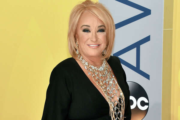 FILE - This Nov. 2, 2016 file photo shows Tanya Tucker at the 50th annual CMA Awards in Nashville, Tenn. Tucker is postponing tour dates after fracturing a vertebrae and injuring a rib during a fall while on tour. A statement from her publicist released Wednesday, Jan. 11, 2017, said Tucker was also diagnosed with bronchitis while in the hospital in Texas. The statement said she is receiving breathing treatments and physical therapy, but will not have to have surgery. (Photo by Evan Agostini/Invision/AP, File) ORG XMIT: NYET419