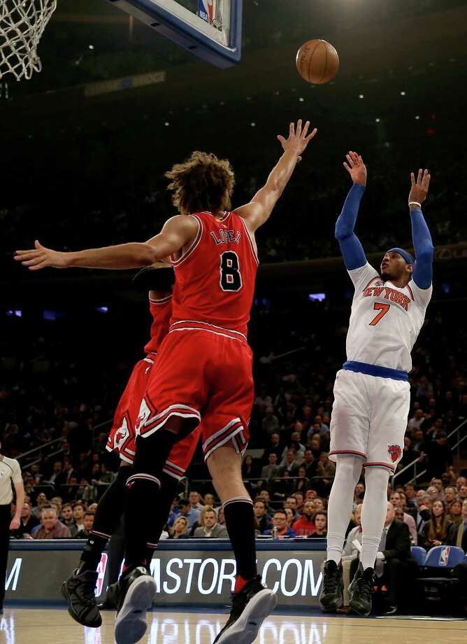 NEW YORK, NY - JANUARY 12:  Carmelo Anthony #7 of the New York Knicks takes a shot as Robin Lopez #8 of the Chicago Bulls defends at Madison Square Garden on January 12, 2017 in New York City. NOTE TO USER: User expressly acknowledges and agrees that, by downloading and or using this Photograph, user is consenting to the terms and conditions of the Getty Images License Agreement  (Photo by Elsa/Getty Images) ORG XMIT: 662354563 Photo: Elsa / 2017 Getty Images