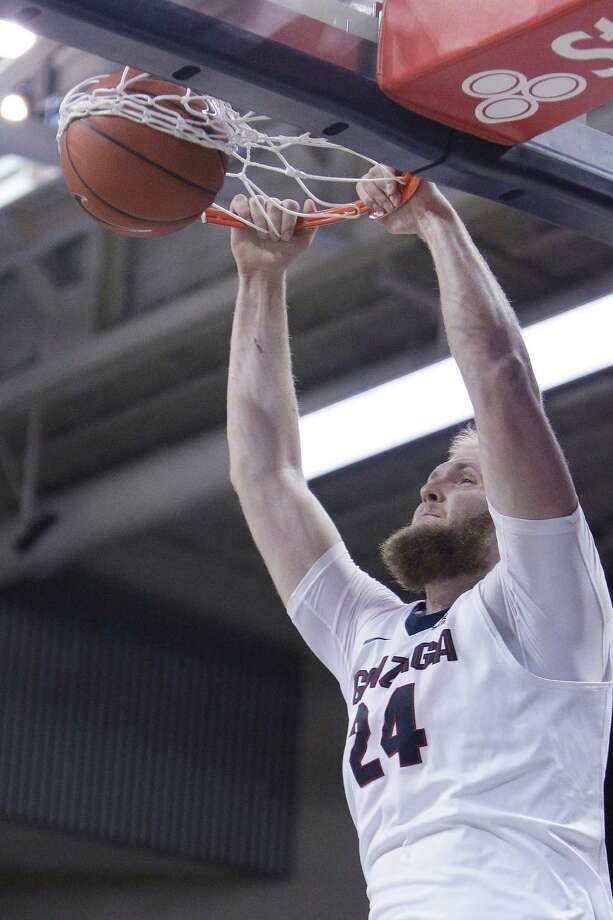 Gonzaga center Przemek Karnowski dunks during the first half of the team's NCAA college basketball game against Loyola Marymount in Spokane, Wash., Thursday, Jan. 12, 2017. (AP Photo/Young Kwak) ORG XMIT: WAYK101 Photo: Young Kwak / FR159675 AP